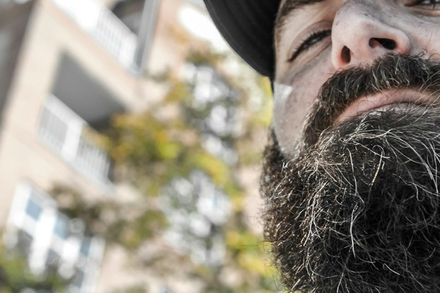 bearded man outside | Struggling with Beard Balding? | How to Fix a Patchy Beard