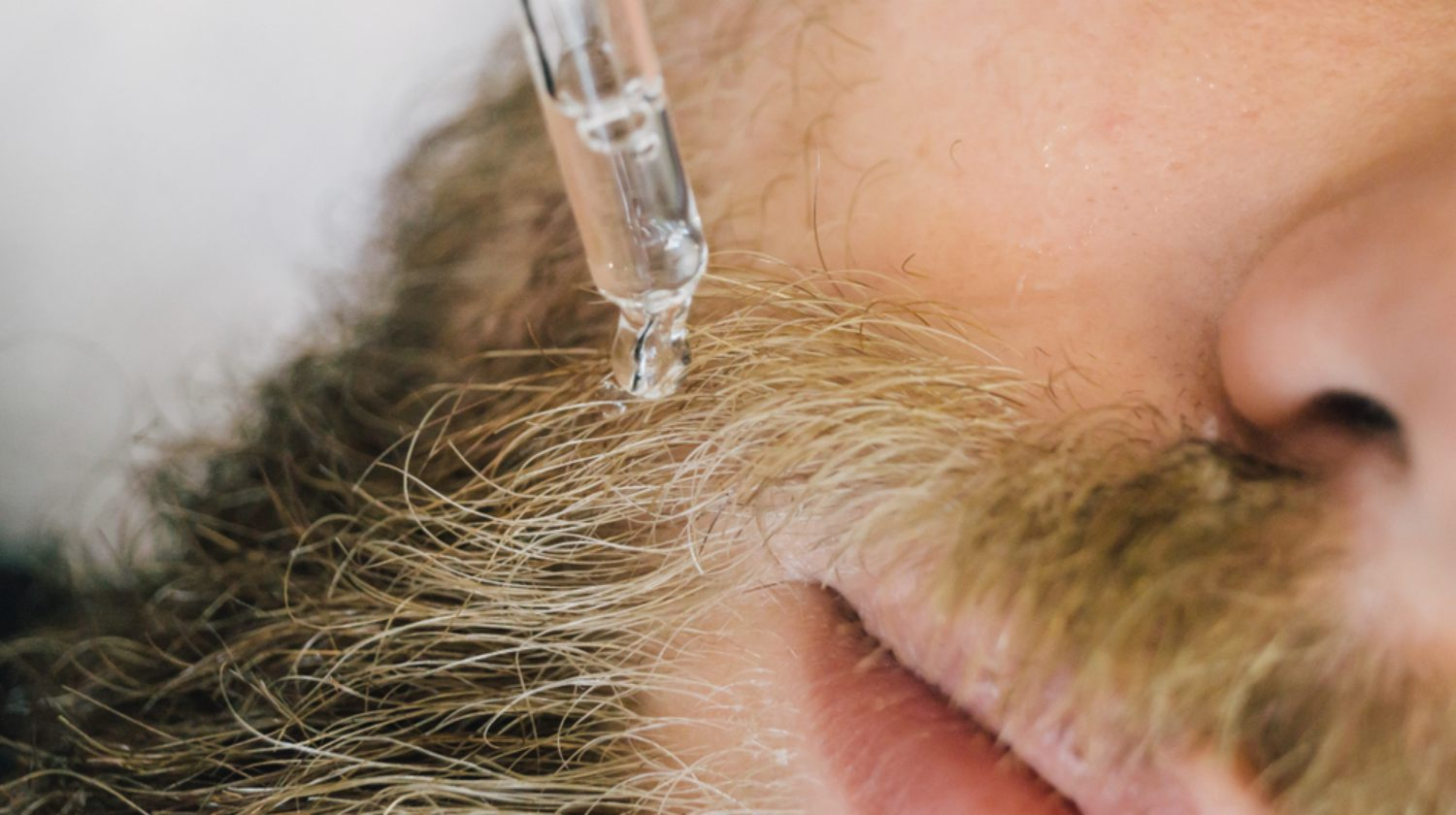Feature | Applying gel serum on bearded man face using glass pipette | Wonders of Using Coconut Oil for Beard Care and Grooming