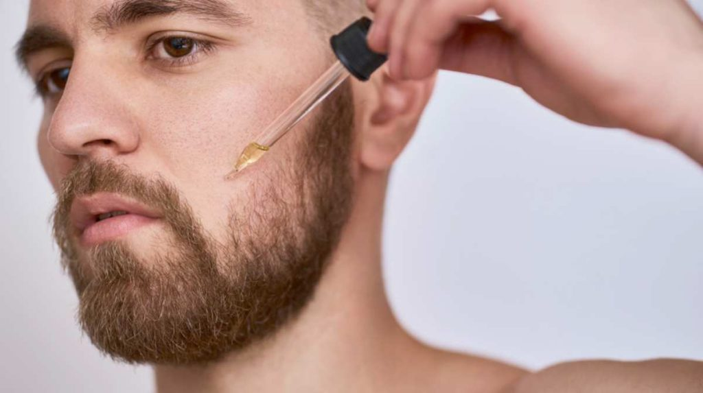 handsome man pipette beard | Jojoba Oil | Why You Should Use It For Your Beard | what is jojoba oil
